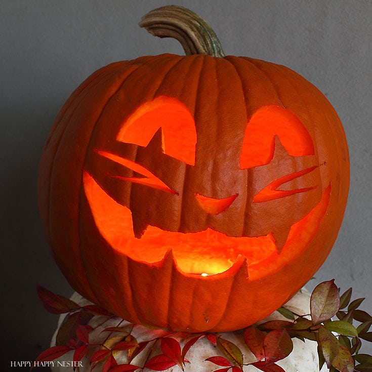 essential pumpkin carving tips and tricks - jack-o-lantern lit up with a candle