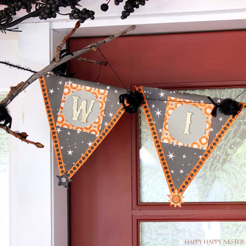 wicked garland hanging on a red door