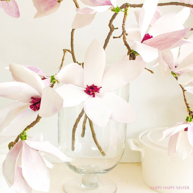 A magnolia paper flower tutorial you won't want to miss. I made this flower out of watercolor flower petals and added them to a tree branch, and you have lifelike flowers that you can make from paper. #DIY   #paperflowers   #crafts   #fauxflowers