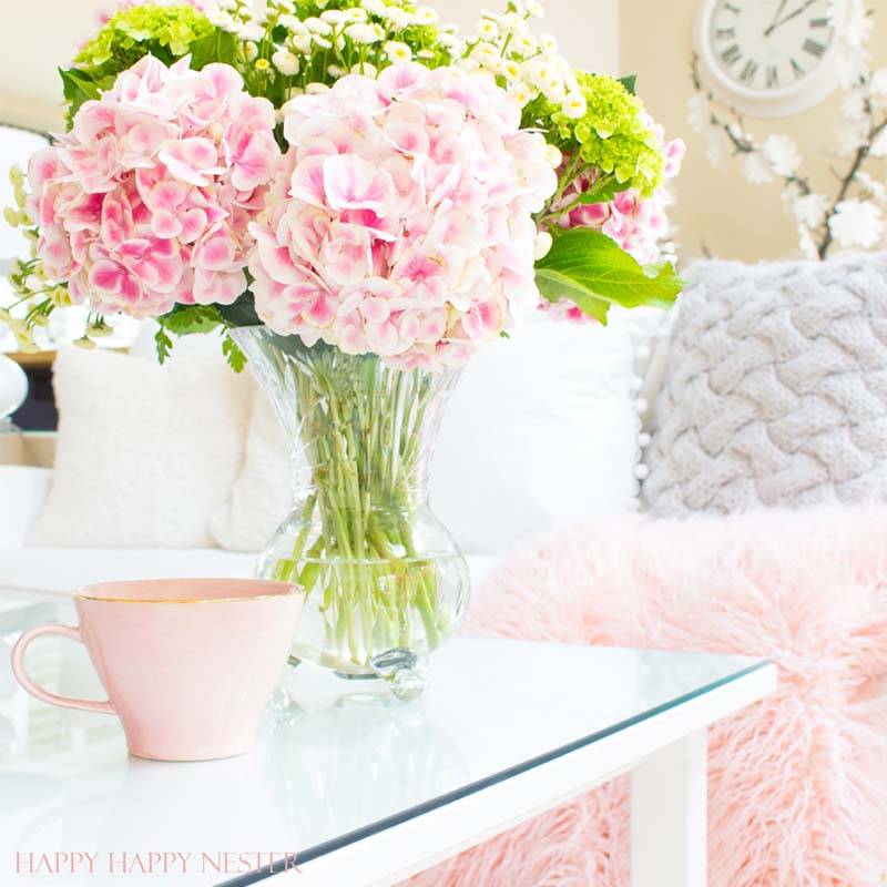Decorating with pink is easy. Pink is getting a new look, and you should add some splashes in your home. I have two versions that introduce spring into my living room. I have some easy tips on quickly adding a few accents to your decor. Diy | decorating | blush | pink | millennials | trends