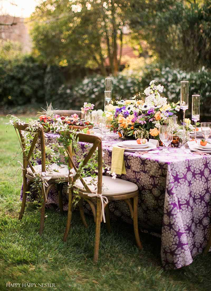 Take your spring table setting outdoors and add some gorgeous flower centerpieces to create a memorable & Spring Table Setting: Beautiful Flower Centerpieces - Happy Happy Nester