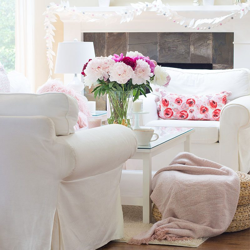 pink living room decor with peonies on a coffee table