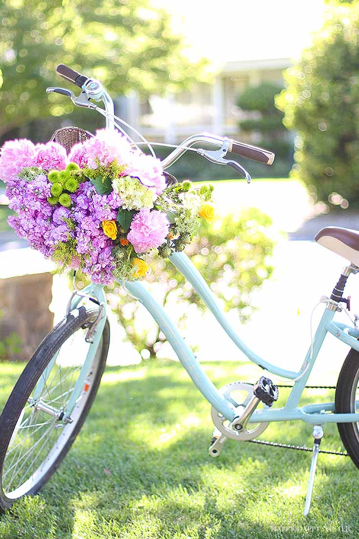 aqua cruiser bike with basket of flowers