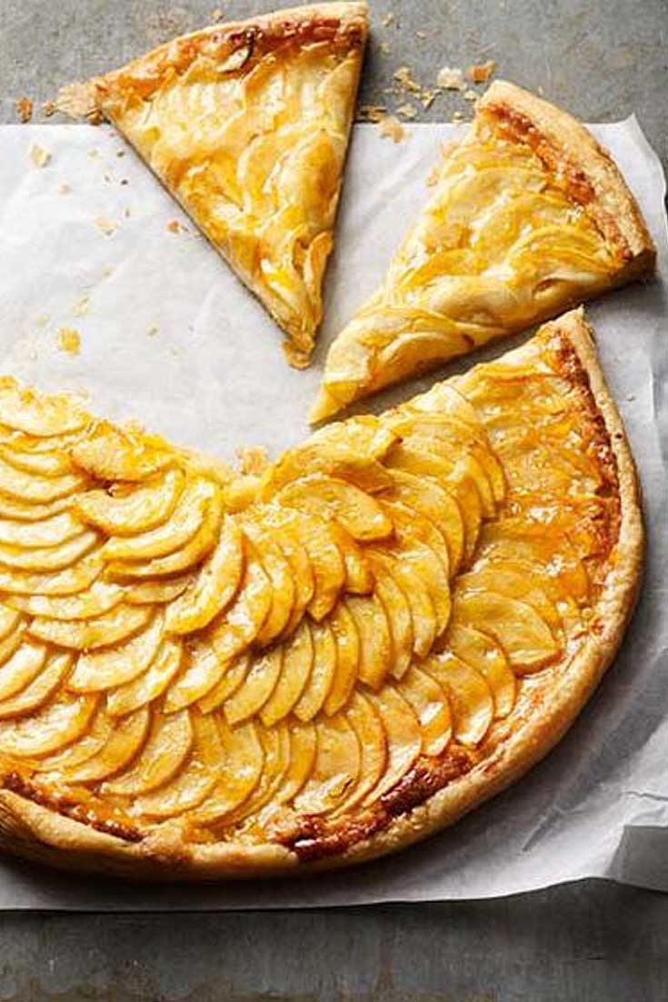 apple tart and slices on wax paper