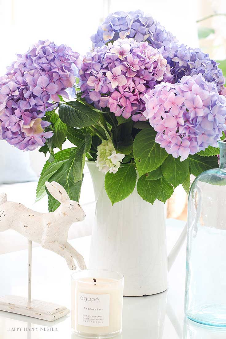 white pitcher with purple hydrangeas