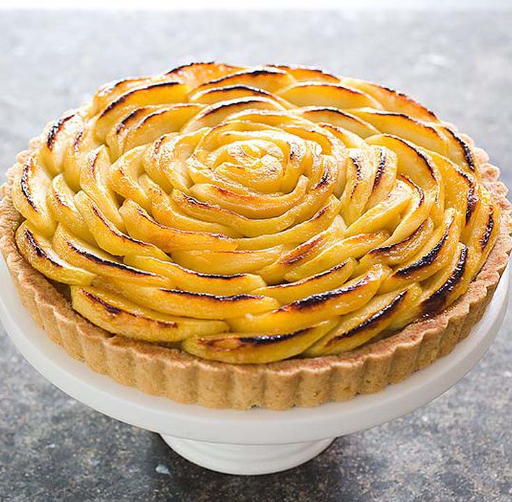 apple tart on a white cakestand