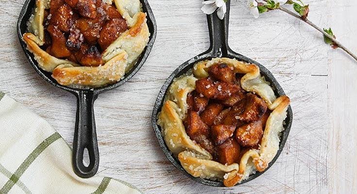 mini apple tarts in cast iron pans