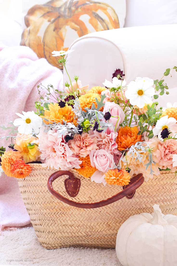 Basket full of orange and pink flowers in my fall home tour with untraditional colors