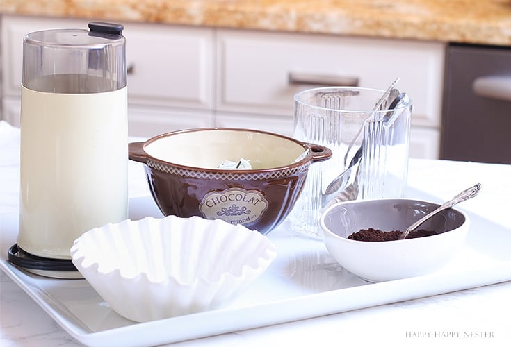 coffee items on a white tray in the kitchen