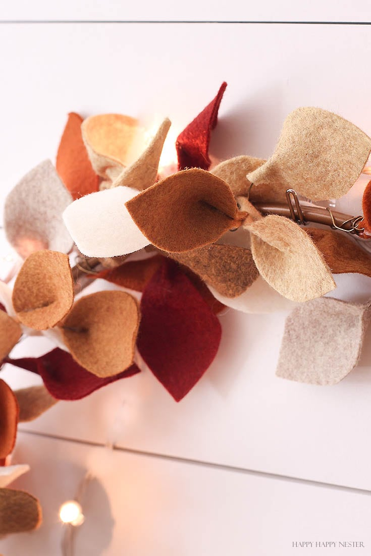 close up of felt leaves on hoop wreath