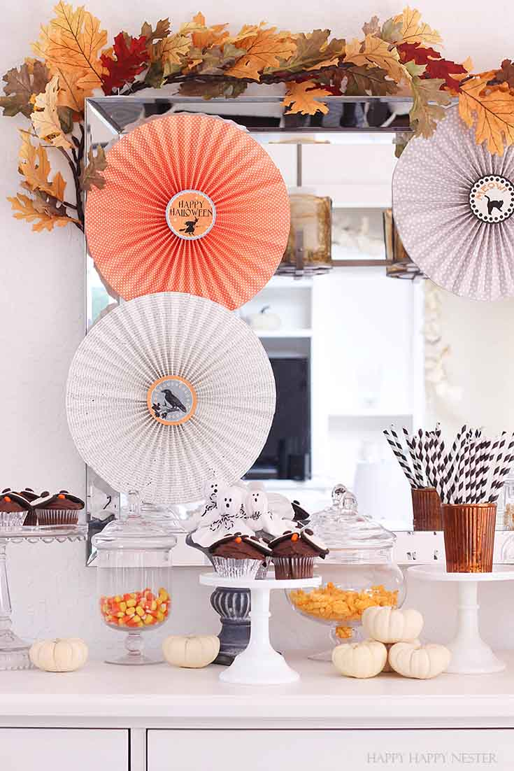 buffet decked out with paper rosettes and Halloween treats