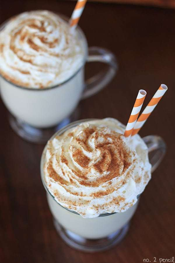pumpkin latte with two orange straws on top
