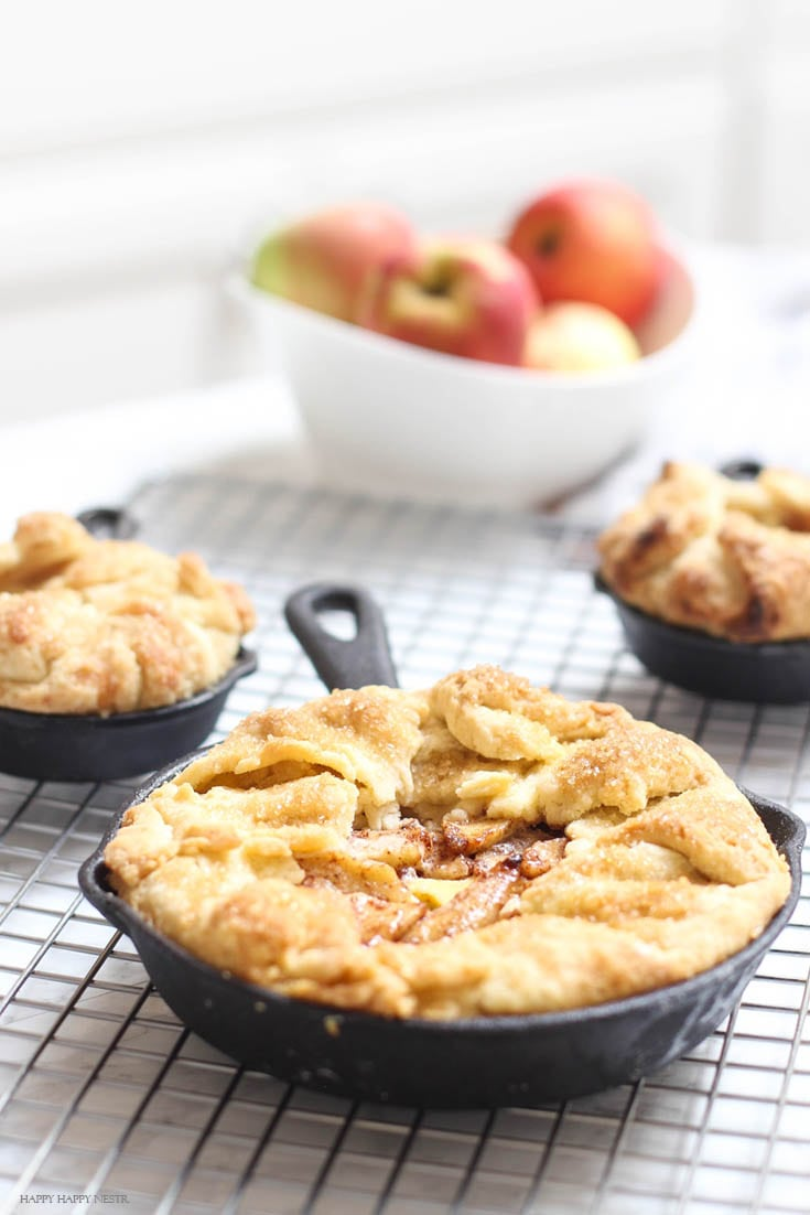 mini apple tart with custard in cast iron pans