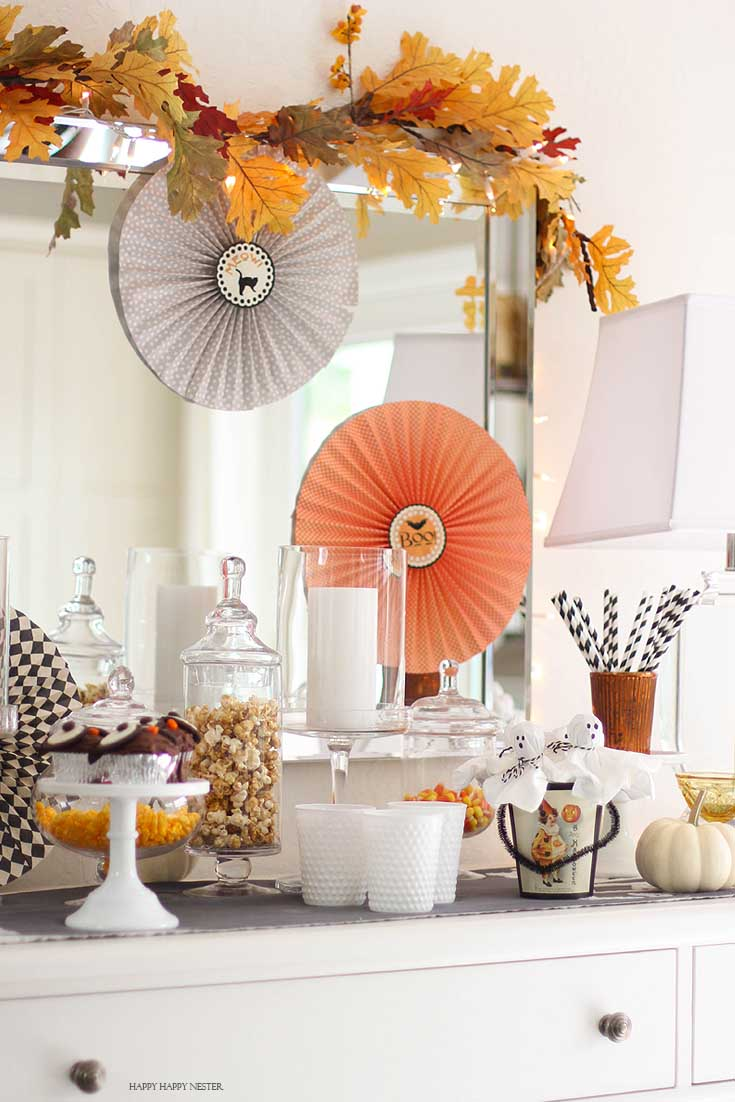 paper pinwheels with a buffet filled with Halloween candy