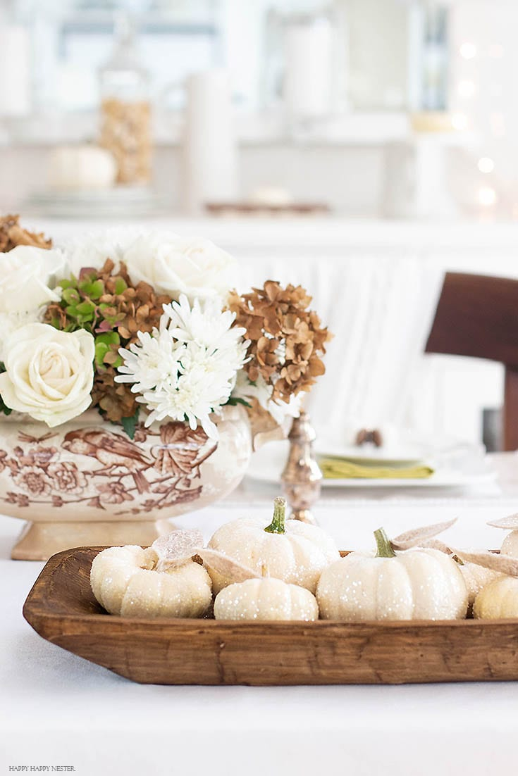 how to make glitter pumpkins displayed on table