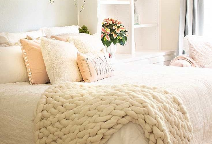 Here are 9 Simple Ways to Add Holiday Cheer to a Bedroom. In this tutorial, I show how easy it is to add holiday decor to a bedroom to make it ready for a guest or just family. Candles, poinsettias, twinkle lights, and pillows to name a few. Decorating | Holidays | Christmas | Christmas Decor | Holiday Bedroom Decor