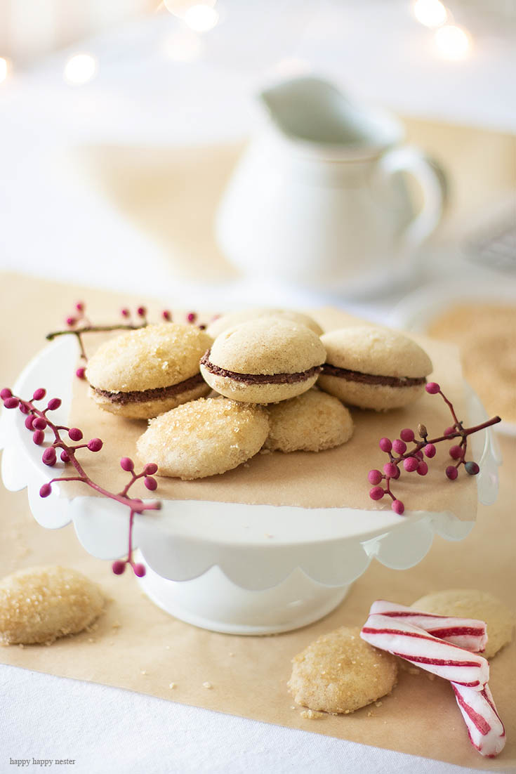 Brown Butter Sugar Cookies with Chocolate Ganache are rich with a light taste and luscious chocolate. This gourmet cookie will become a favorite on your first bite. Brown butter adds a nice rich and nutty flavor. Baking | Cookie | Sugar Cookie | Recipes | Desserts | Brown Butter | Best Cookie | Gourmet Cookies | Recipe