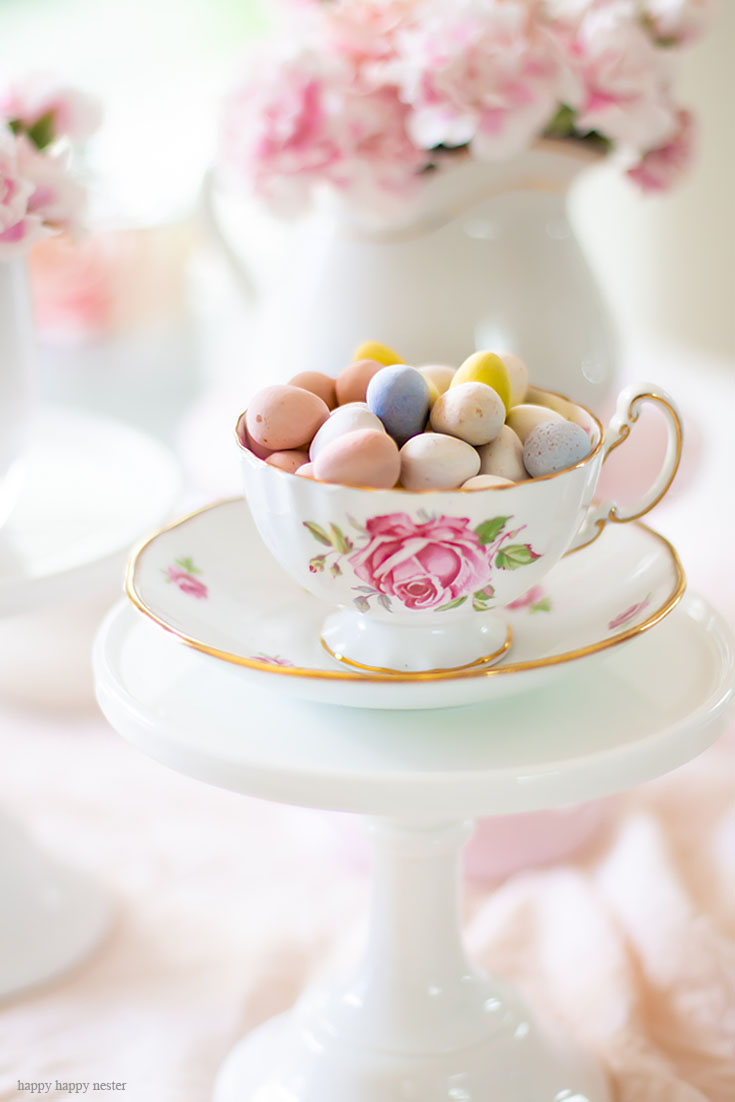 Use cake stands as candy holders. Cake stands are easy ways to decorate a table or your home. I have gathered some Cute Ways to Use a Cake Stand that I'm sure you'll love. You can use them for the holidays or even a wedding reception. They add drama and interest because of their styles and heights. #cakestands #decorating #weddings #flowers #decor