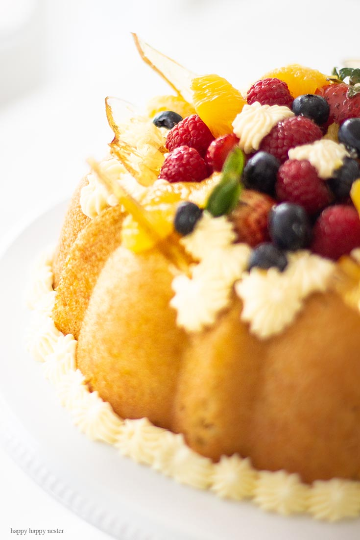 The Best yeast cake. Here is a Yeast Cake Recipe that is soaked thoroughly in an Orange Grand Marnier syrup. This cake is topped with a Sabayon cream frosting and fresh fruit. This unique yeast cake is a bit rustic and very gourmet in taste. It is an impressive cake. Cake | French Cake | Baking | Gourmet Desserts | European Cake